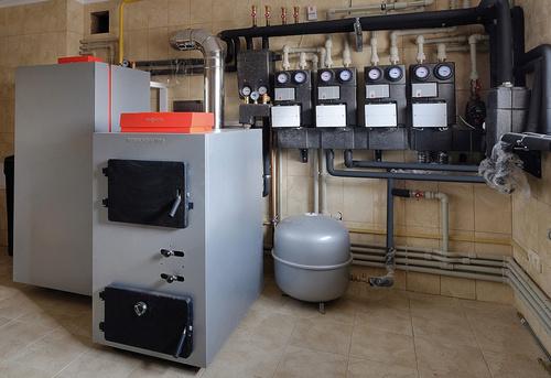 Монтаж твердотопливного отопления в частном доме в Ногинске